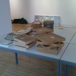 Unloading framed works.