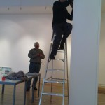 Simon Cutts and Caspar installing the neon.