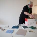 Simon Cutts throwing books.