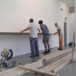 Installing a big shelf.